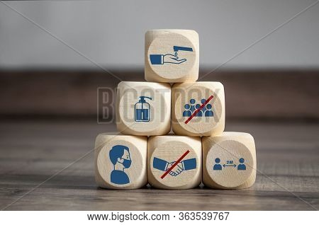 Pyramide Made Of Cubes And Dice With Hygiene Icons Covid-19 Corona Virus On Wooden Background