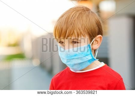 Face Mask For Protection Coronavirus Outbreak. Boy With Protection Facemask. Coronavirus Quarantine.