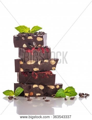 Chocolate With Nuts And Raspberries And Fresh Mint Leaves. Dark Chocolate. Confectionery Homemade. C