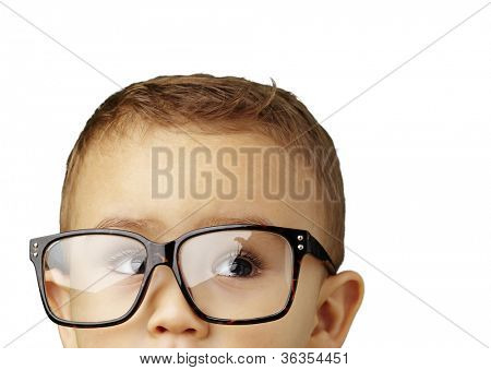 portrait of a kid wearing glasses against a white background