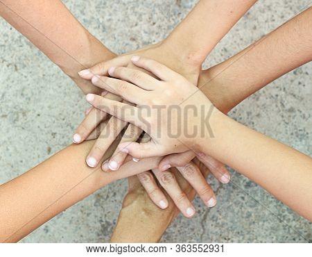 Teamwork Concept - People Holding Hand Together