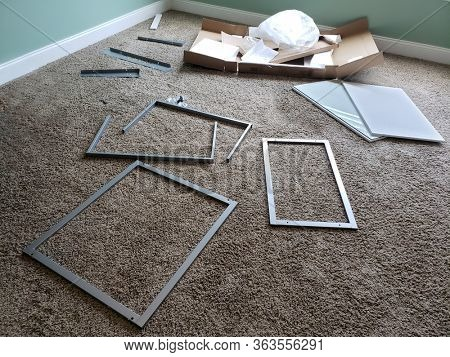 Assembly Required Desk in Pieces Spread Out on FLoor