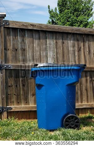 Trash can supplied by the city for residential trash pickup.