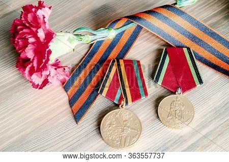 9 May Victory Day Card With Jubilee Medals Of Great Patriotic War, Red Carnations And George Ribbon