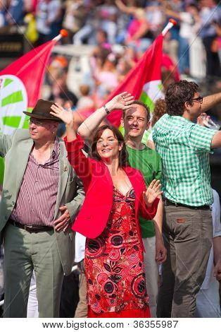 AMSTERDAM, THE NETHERLANDS - AUGUST 4: Politician Jolanda Sap in front of spectators at the famous Canal Parade of the Amsterdam Gay Pride 2012 on August 4, 2012 in Amsterdam