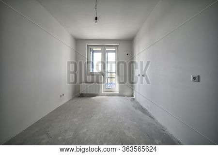 Construction Site Of Residential Apartment Renovation. Empty Room Before Reimbursement New Concrete