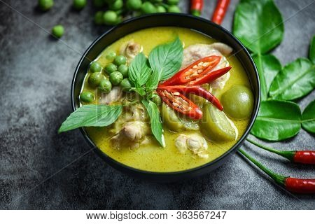 Thai Food Green Curry On Soup Bowl With Ingredient Herb Vegetable On Dark Plate Background / Green C