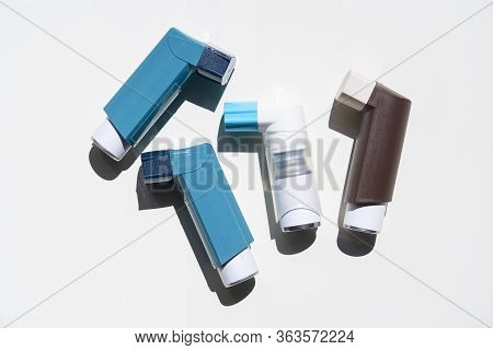 Many Asthma Inhalers On White Background, Flat Lay