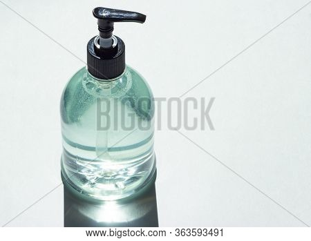 Clear Hand Sanitizer In A Clear Pump Bottle Isolated On A White Background. Hand Sanitizer Is Used F