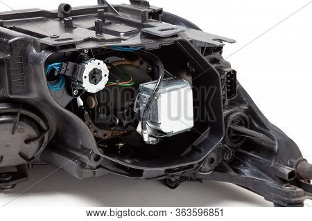Plastic Spare Part Of A Black Car On A White Background - Rear View Xenon Headlight Inside Electrica