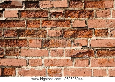 Crumbled Brick Wall Texture For Background. Weathered Destruction Of Ancient Brick Building Wall.fra