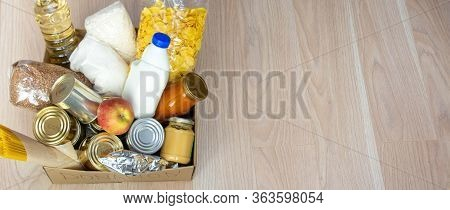 Canned Food, Pasta And Cereals Cardboard Box. Food Donations Or Food Delivery Concept.
