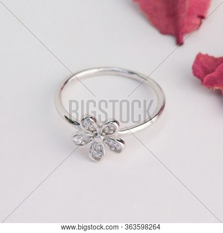 Silver Ring In The Flower Shape Decorated With Diamond Isolated On White Background