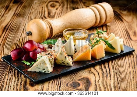 Cheese Plate With Cheeses Dorblu, Parmesan, Brie, Camembert And Roquefort In Serving On The Table Fr