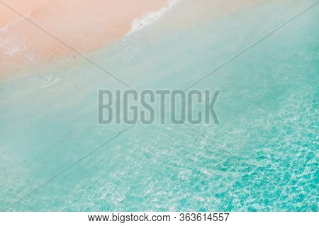 Tropical Beach With A Birds Eye View Of The Waves Breaking On The Tropical Golden Sandy Beach. Sea W