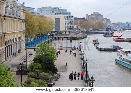 London, Uk - April 22, 2016: People Walk Along Thames Embankment In London, Uk. London Is The Most P