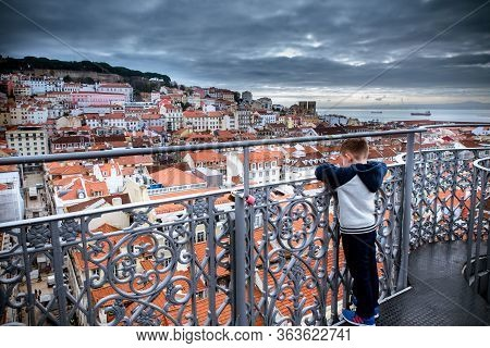 March 1, 2017. Lisbon, Portugal: Child Boy Looks At The City On The Observation Deck Of Santa Justa