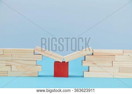 Bridge Help. Safety Net. Financial Help. Business Support. Wooden Planks On Red Cube Between Bridge