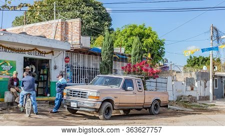 Guadalajara, Jalisco, Mexico. January 14, 2020. Group Of Men Chatting Outside An Auto Parts Store, O