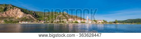 Panorama Of Duernstein And River Danube In Wachau Valley, Austria With Blue Abbey Church And Ruins O