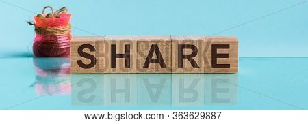 Share - Word From Wooden Blocks With Letters, To Divide Or Use Something With Others Share Concept,