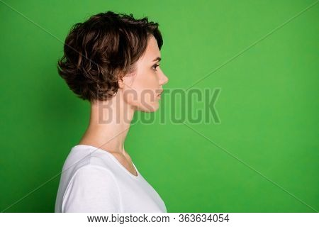 Closeup Profile Photo Of Attractive Lady Short Wavy Hairdo Not Smiling Look Side Empty Space Concent