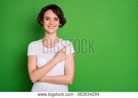 Photo Of Attractive Lady Wavy Hairdo Direct Finger Side Empty Space Demonstrating Cool Shopping Nove