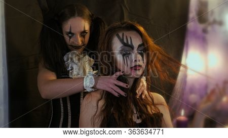 Easy Halloween Makeup. Woman Put Her Hands On The Other Girls Neck. Horror In The Eyes Of A Man. Peo