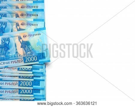 Russian Banknotes Of 2000 Rubles. On The Right There Is A Place For Text. The Background Is White. T