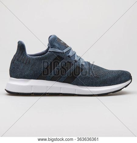Vienna, Austria - February 19, 2018: Adidas Swift Run Blue, Black And White Sneaker On White Backgro