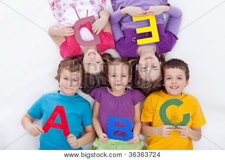 Group of kids holding alphabetical letters - back to school together