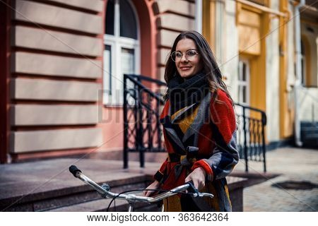 Mirthful Young Woman With Bike In The Street