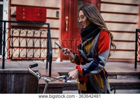 Mirthful Lady Sending Messages During Her Walk