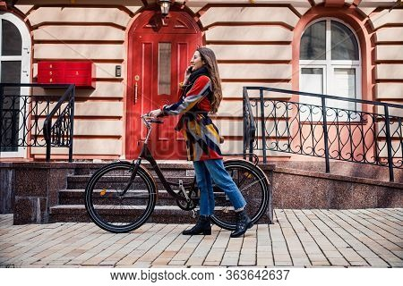 Mirthful Lady With Her Bike And Smartphone Stock Photo