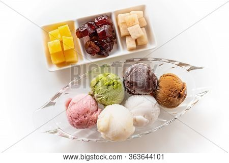 Top View Multi-colored Ice Cream In A Clear Dish And Sweet Processed Fruit For Eating Together In Vi