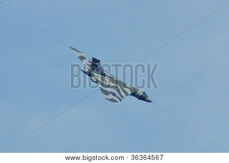 EASTBOURNE, ENGLAND - AUGUST 11: Avro Vulcan B.Mk2, XH558, performs at the Airbourne airshow on August 11, 2012 at Eastbourne, East Sussex. Built in 1960, it is the last airworthy Vulcan.