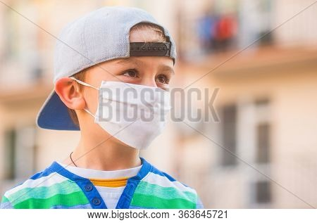 Boy In A Surgical Bandage. Boy In A Medical Mask. Quarantine And Protection Virus. Coronavirus Quara