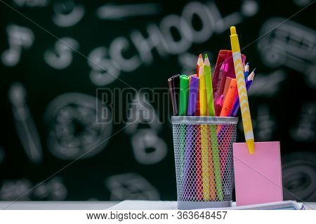 School Background With Stationery Accessories. Books, Globe, Pencils And Various Office Supplies Lyi