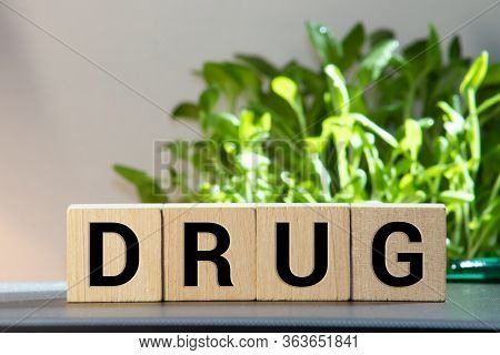 Letter Block In Word Drug On Wood Background