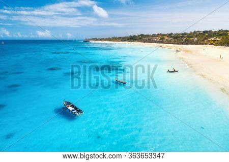 Aerial View Of Fishing Boats And Yachts On Tropical Sea Coast With Sandy Beach At Sunset In Summer.