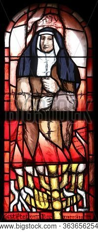 HOHENBERG, GERMANY - MAY 06, 2014: Saint Edith Stein, stained glass window by Sieger Koder in St. James church in Hohenberg, Germany