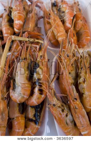 Prawns grilled on paper plate on a market in Bangkok poster