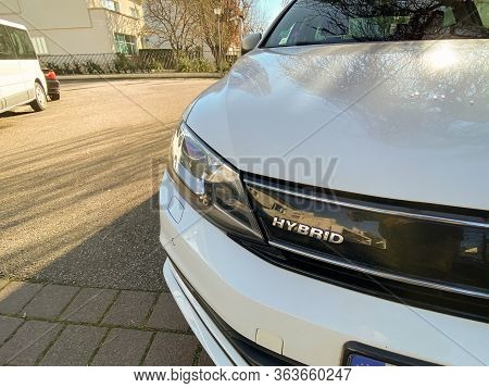Paris, France- Feb 6, 2020: Front View Of Logotype On The New Volkswagen Golf Hybrid Car Parked On F