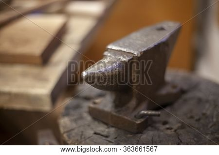 Anvil For Forging Metal. Iron Item. Vintage Background On The Theme Of Metal Processing. Tool In The