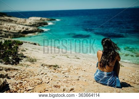 Young Woman Sitting Alone At The Beach.self Isolation In Nature.coronavirus Quarantine Lockdown Beac