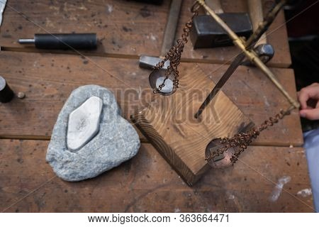 Manual Coinage. Coinage In The Anvil. Work Place. Scales With Coin.