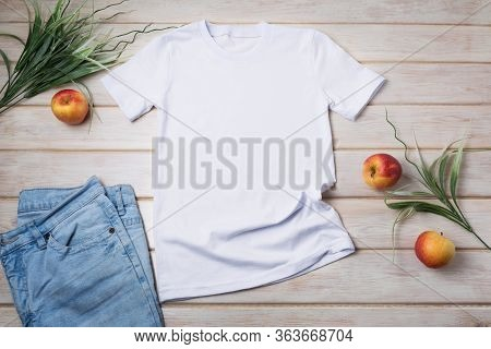 White Unisex Cotton T-shirt Mockup With Green Grass And Apples. Design T Shirt Template, Tee Print P