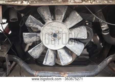 Damaged Car. Dents On The Machine Body. Rust And Scratches. A Deflated Wheel And Other Parts Requiri