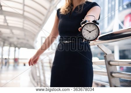 Business Women Show Alarm Clock And Shocked With Late In Rush Hours When Going To Work In City Urban