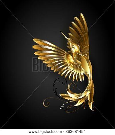 Hand Made Painter Golden Hummingbird On Black Background. Gold Bird.